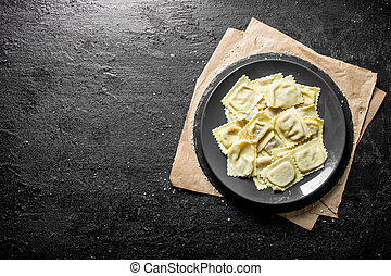 Ravioli with meat on a plate.