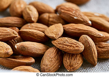 Raw almond food background, close-up, shallow depth of field, macro.