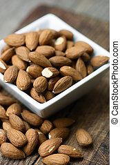Raw almond on wooden background