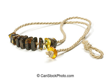 Raw amber necklace isolated on the