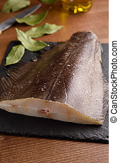 Raw Atlantic halibut on a slate board