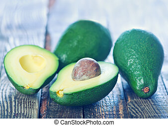 avocado - raw avocado on the wooden board, fresh avocado