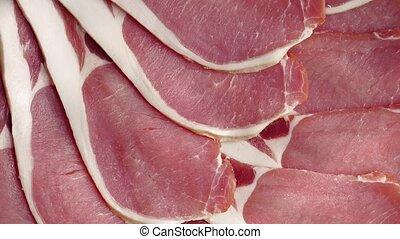 Raw Bacon Rotating - Raw bacon platter rotating slowly