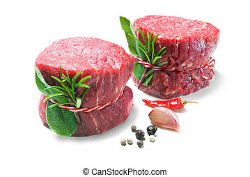 Raw beef fillet steaks mignon isolated on white background