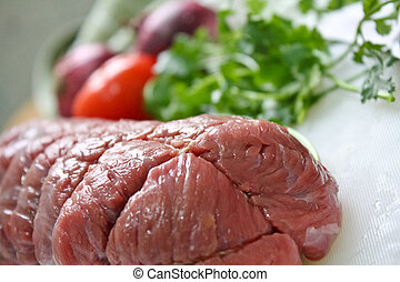 Raw Beef Meat with ingredient on a plate