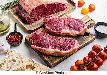 Raw beef steak burger ingredients with marbled meat, on white background