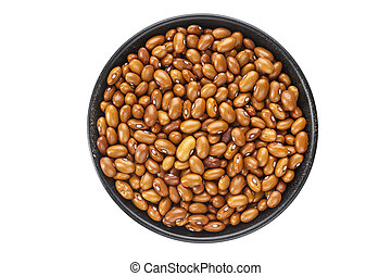 brown beans in a plate isolated