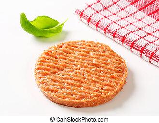 Raw burger patty - studio shot