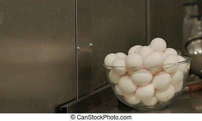 Raw chicken eggs in glassware white color