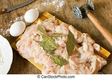 raw chicken fillet  eggs  and flour
