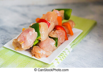 Raw Chicken Kebabs With Baked Potatoes