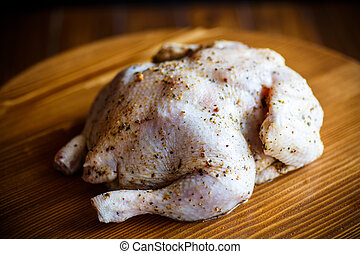 Raw chicken marinated with spices