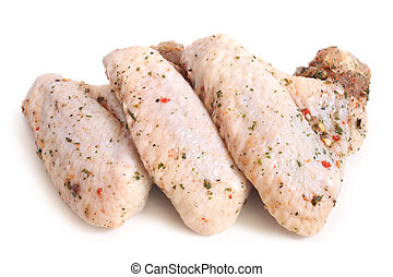 Raw chicken wings with condiments