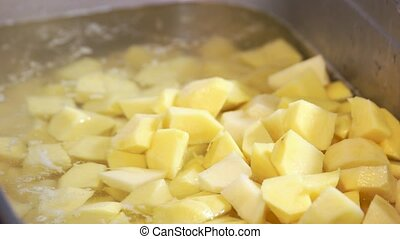 Raw chopped potatoes close up. Vegetable and water.