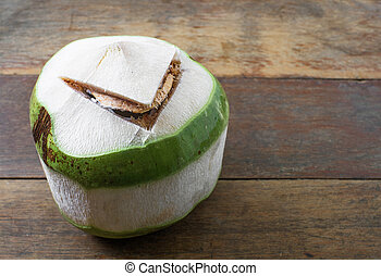 raw coconut on wood background