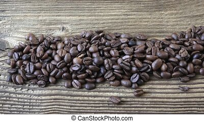 Raw coffee beans. Coffee beans on wood background.