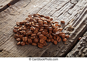 Raw coffee beans on table