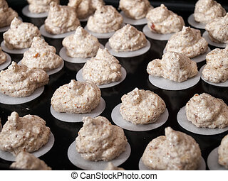 Raw walnut cookies are ready for baking.