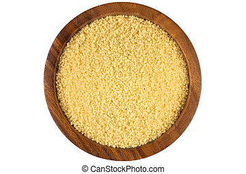 Raw couscous in a wooden bowl