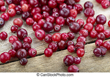 raw cranberries scattered on the table