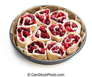 Raw Cranberry buns in metal baking form. Ready for baking.