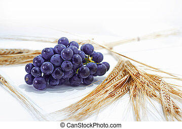 Raw dark grapes isolated on white background.