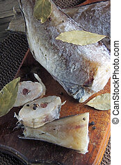Raw Fish. Heck - Frozen Raw Fish with spices on wooden ...