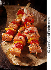 Raw Fish Kebabs on Paper on Top of a Table