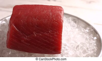 Raw fish meat on ice.