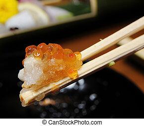 raw fish roe on chopsticks