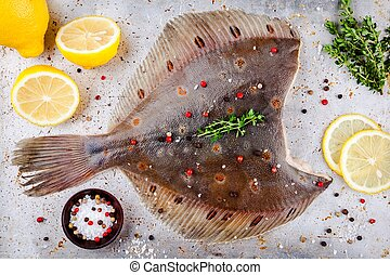 Raw flounder fish, flatfish on rustic background