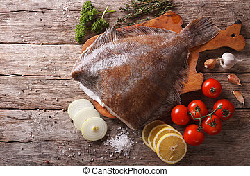 raw flounder with ingredients on a table. Horizontal top ...