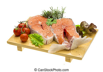 Raw fresh bright salmon with vegetables