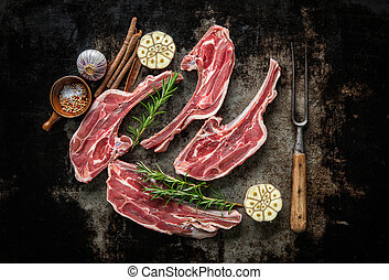 Raw fresh lamb meat on dark background