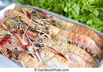 Raw fresh Langoustines from the market .