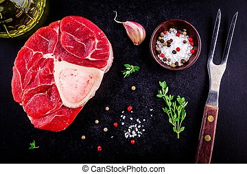 raw fresh veal shank meat for ossobuco on dark background