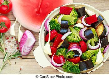 Raw fresh vegetables - broccoli, eggplant, bell peppers, tomatoes, onions, garlic. Preparation garnish