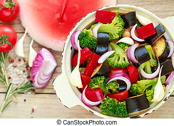 Raw fresh vegetables - broccoli, eggplant, bell peppers, tomatoes, onions, garlic. Preparation garnish