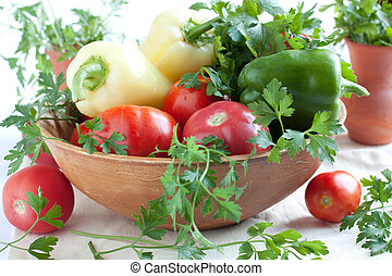 Raw fresh vegetables in a large bowl
