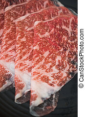 Raw freshly prepared sliced beef for hot pot