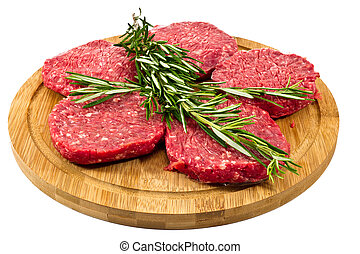raw hamburgers with cellophane and rosemary on wooden board isolated on white background