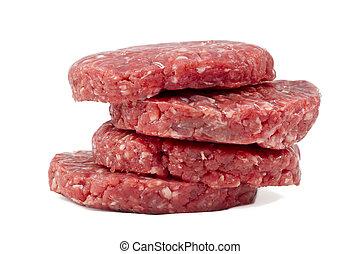 raw hamburgers with transparent protective film - raw ...