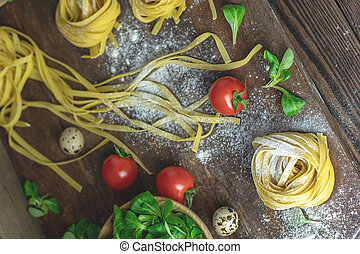 Raw homemade Italian typical pasta linguine noodles, quail...