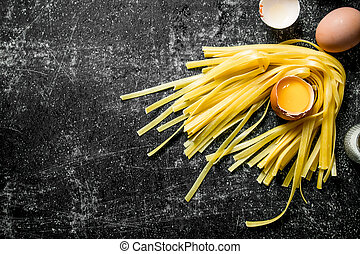 Raw homemade pasta with eggs.