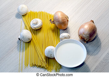 spaghetti, onion, mushrooms and cream in a bowl