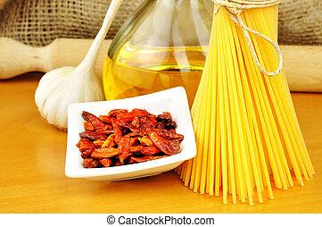 Raw ingredients for spaghetti aglio, olio e peperoncino