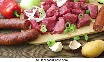 Raw ingredients for stew, goulash or soup. Fresh raw chopped...