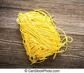 pasta on a dark wooden background