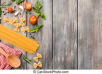 Raw Italian pasta with tomato sauce ingredients with copy space
