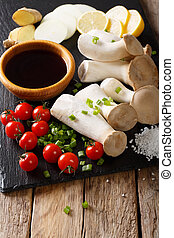 Raw King Trumpet Mushroom with ingredients for cooking...